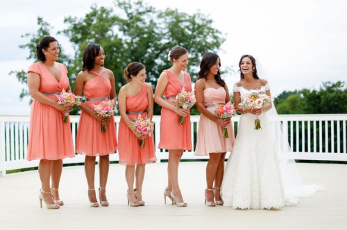 mismatching coral pink knee dresses for the gals and a blush strapless gown for the maid of honor