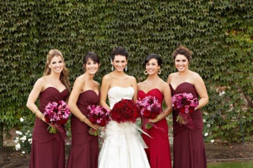 matching strapless burgundy maxi dresses for the gals and a hot red one for the maid of honor
