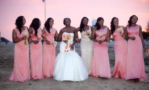 matching pink maxi gowns for the bridesmaids and a neutral lace gown for the maid of honor