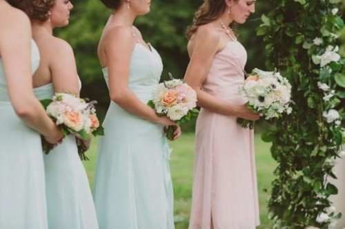 matching light green maxi bridesmaid gowns and a light pink gown for the maid of honor