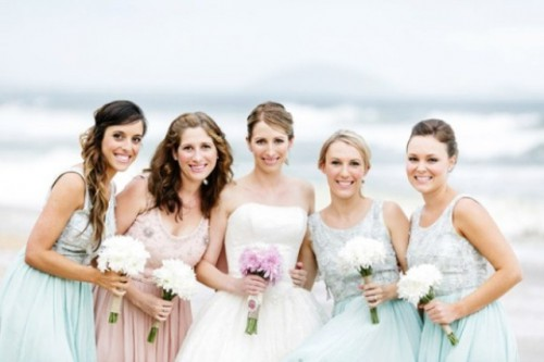 matching embellished mint green gowns for the bridesmaids and a blush embellished dress for the maid of honor