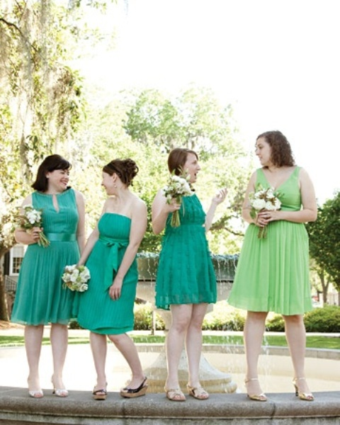 mismatching bright green knee A-line dresses for the bridesmaid and a lighter green gown for the maid of honor