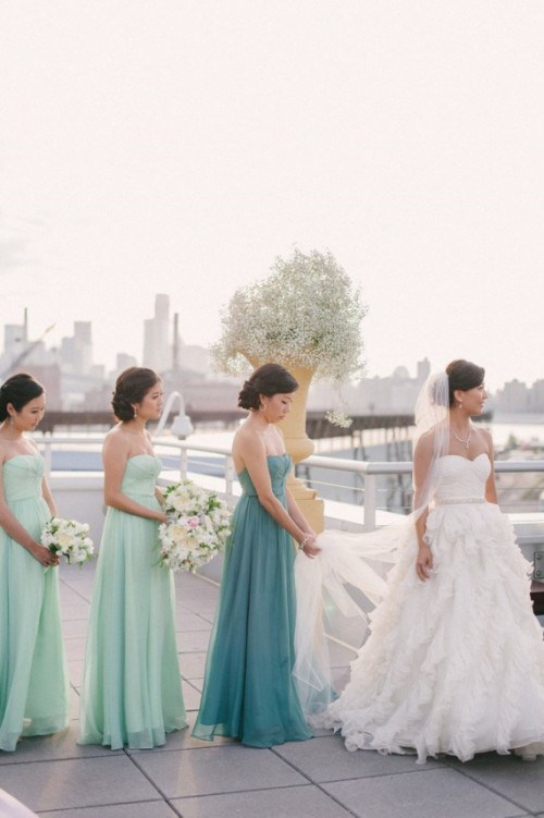matching mint maxi bridesmaid dresses and a blue one of the same design but a different color