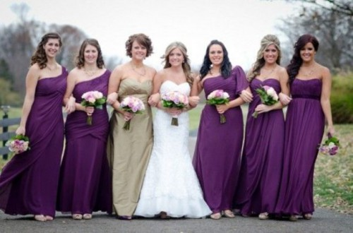 mismatching purple maxi dresses for bridesmaids and a strapless gold maxi gown for the maid of honor