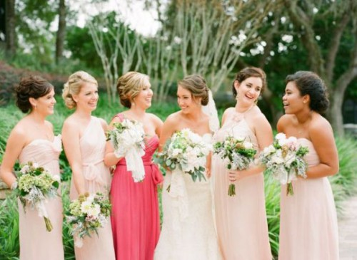 mismatching blush bridesmaid dresses and a one shoulder coral pink maxi gown for the maid of honor