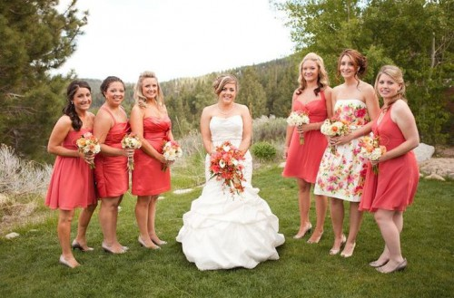 mismatching coral knee bridesmaid dresses and a bright floral gown for the maid of honor