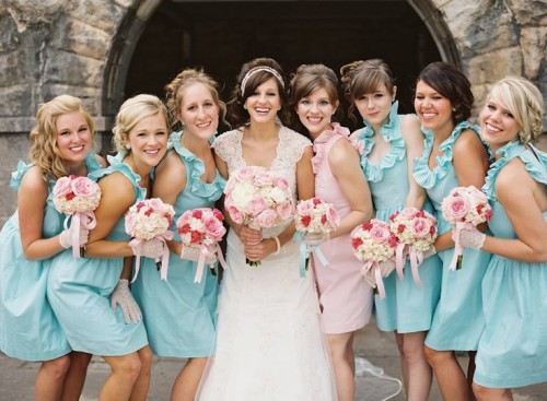 matching light blue short bridesmaid dresses and a light pink gown for the maid of honor