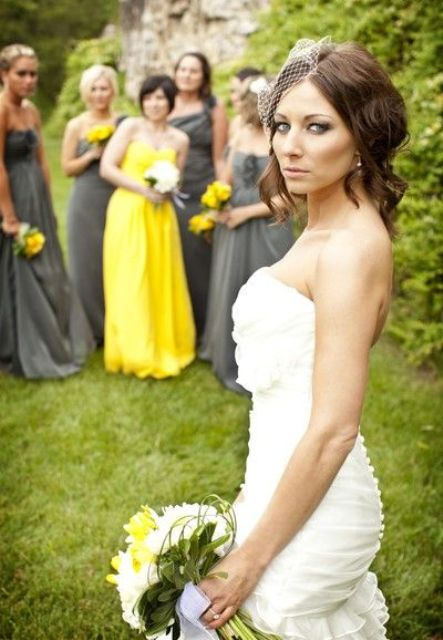 all the gals wearing matching grey maxi dresses and the maid of honor in a bright yellow one for a grey and yellow wedding