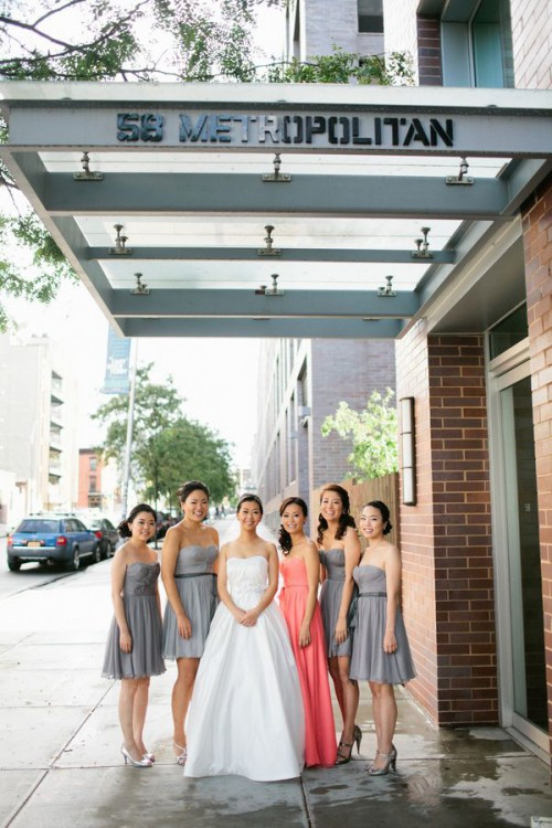 strapless short grey dresses for the bridesmaids and a coral pink maxi one for the maid of honor