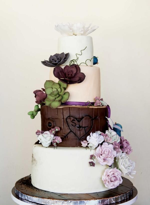 a woodland wedding cake in white and chocolate, with sugar flowers and succulents for cake decor