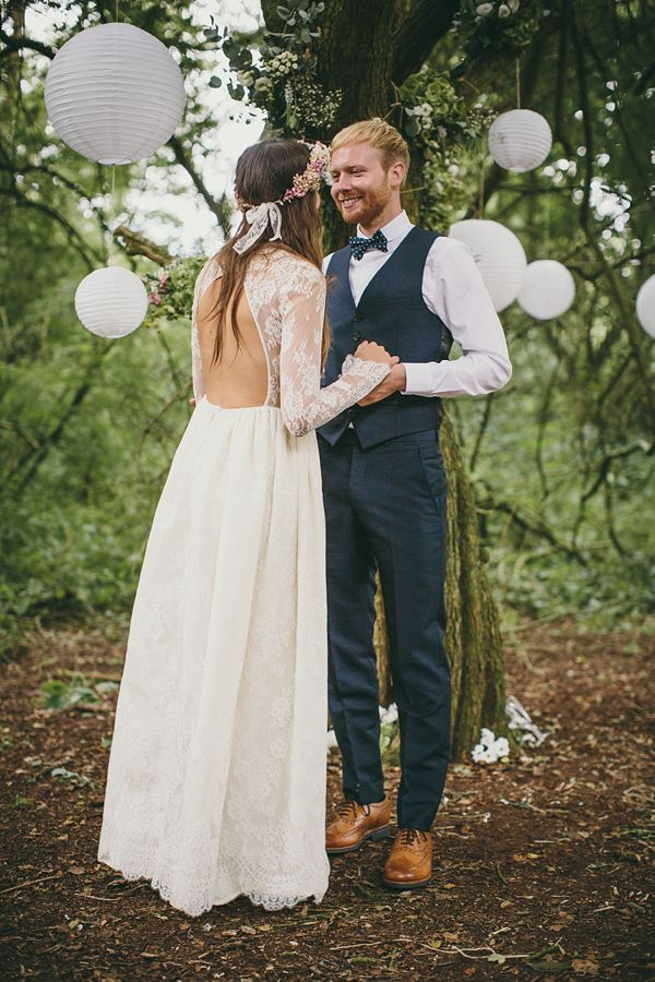 a boho lace wedding gown with a cutout back, long sleeves and a full skirt plus a floral skirt