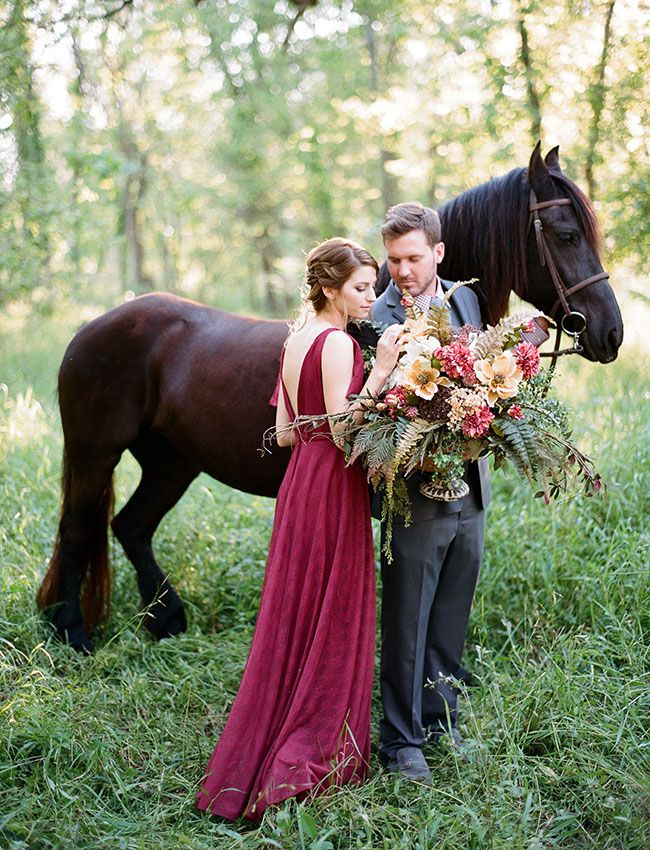 a burgundy thick strap wedding gown with an open back and a V neckline plus a chic updo