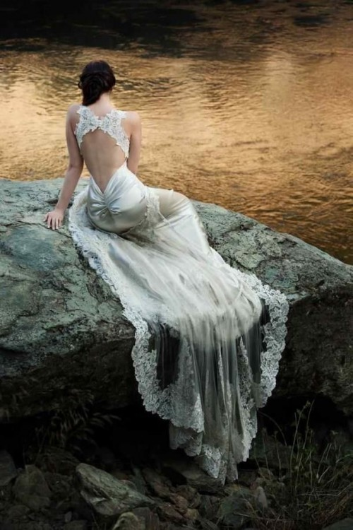 a silk sheath wedding dress with a train, an opeen back and criss-cross lace on the back plus a sheer veil with a lace edge