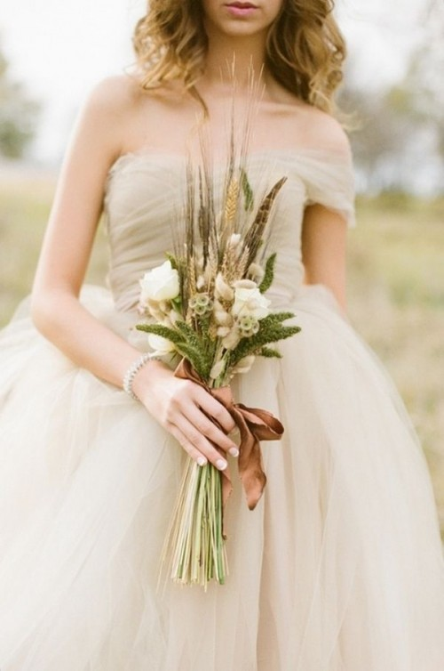 an airy off the shoulder wedding ballgown with a full skirt is a very chic idea