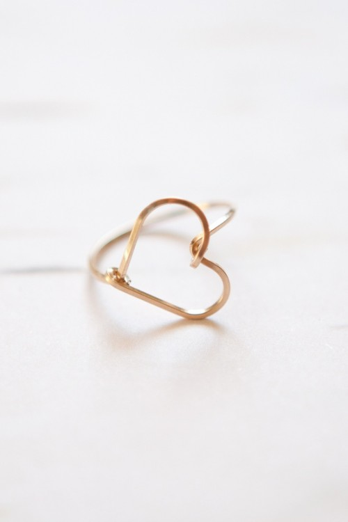 a gold heart-shaped engagement ring is a very romantic and simple solution that is all about love and giivng your heart to somebody
