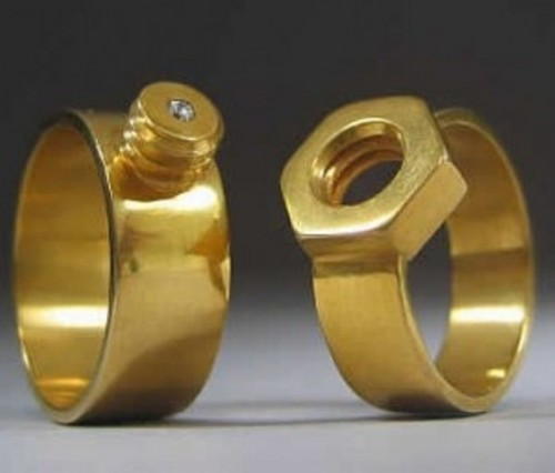 gold screw and nail engagement or wedding rings are a creative idea for an industrial or craft-loving couple