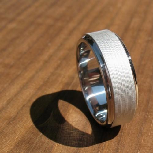 a creative shiny and matte white gold ring can be a great and very laconic accessory - an engagement or wedding ring