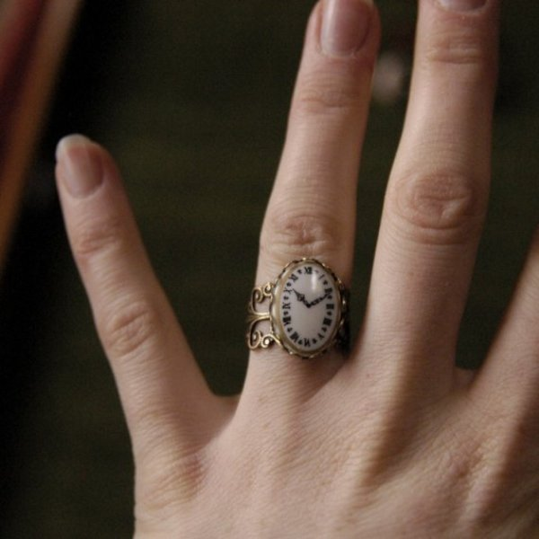 a vintage clock wedding ring is a unique idea for a vintage loving bride