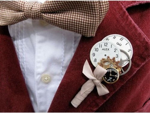 a whimsical wedding boutonniere made of little gears, clocks and a bow is a pretty and quirk y idea for a steampunk groom