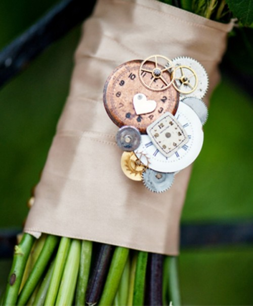 a tan wedding wrap with gears and little clocks attached to the wrap for a steampunk bride
