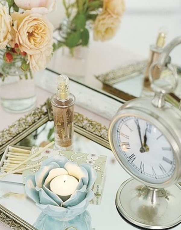 a bride's tray with a perfume, candles and a vintage table clock is a pretty pic of the bridal morning or you can show off your rings on such a tray