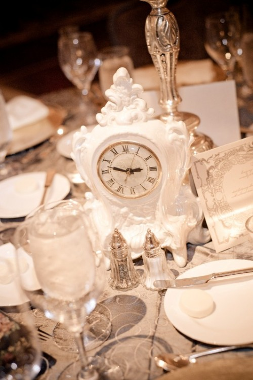 a large vintage white clock used for a wedding centerpiece - a great idea for NYE or vintage wedding