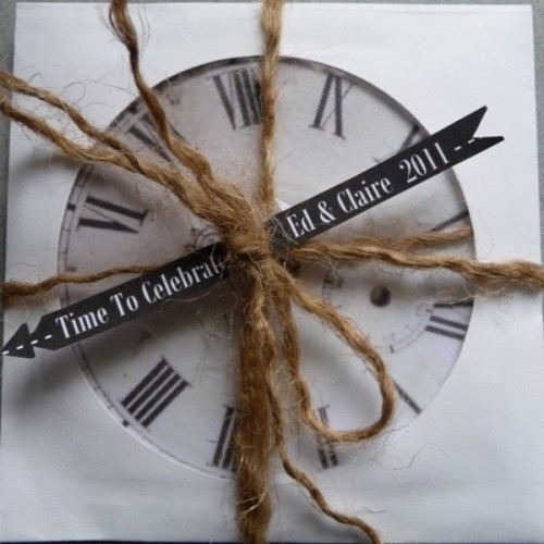 a clock with a tag and twine is a fun and simple wedding favor idea for a NYE wedding