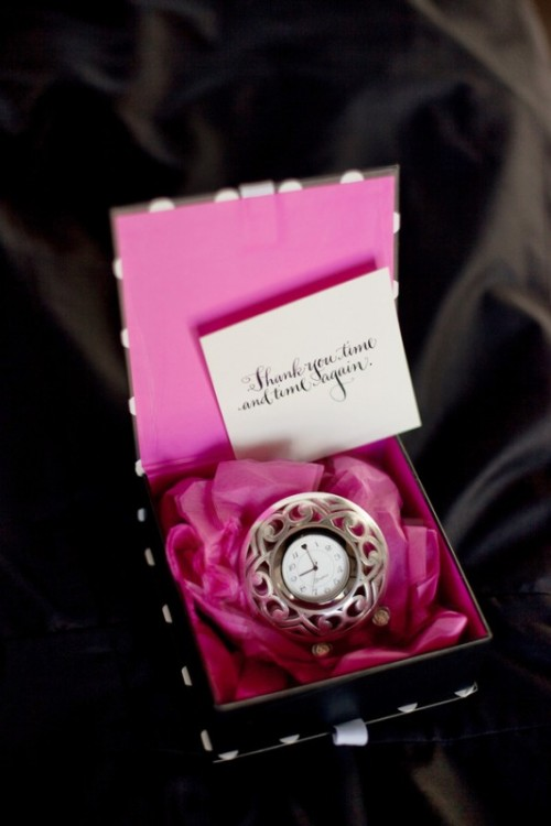 a black and pink box with a clock and a tag is a beautiful wedding favor, especially for a NYE wedding