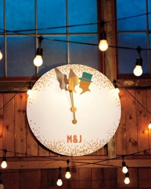 a large clock with gold polka dots, silhouettes and monograms is a pretty wedding decoration for a NYE wedding