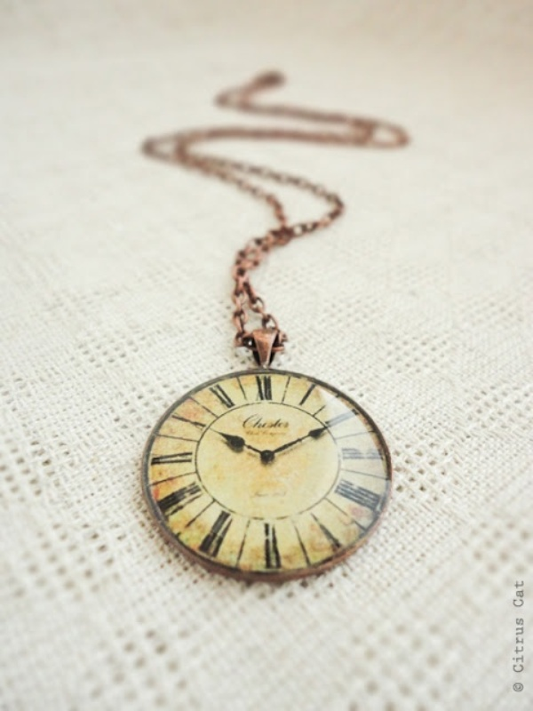 a vintage clock on a copper chain is a cool wedding favor idea or it can be worn by bridesmaids or groomsmen as accessories