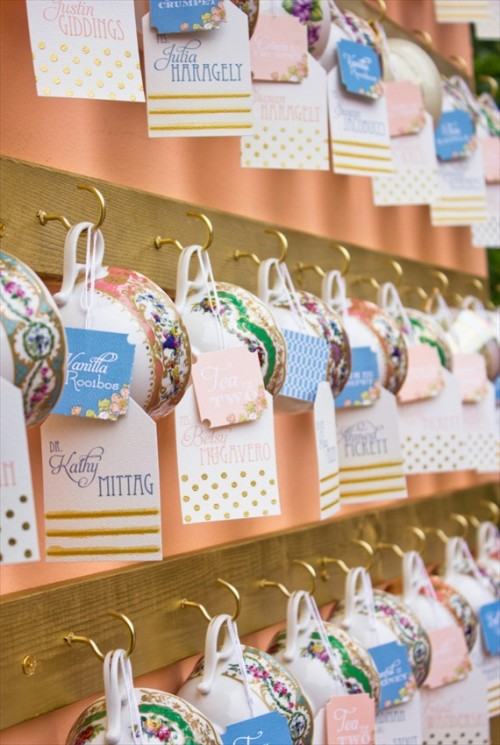 adorable vintage teacups with tags and cards on display are lovely cards and wedding favors at the same time