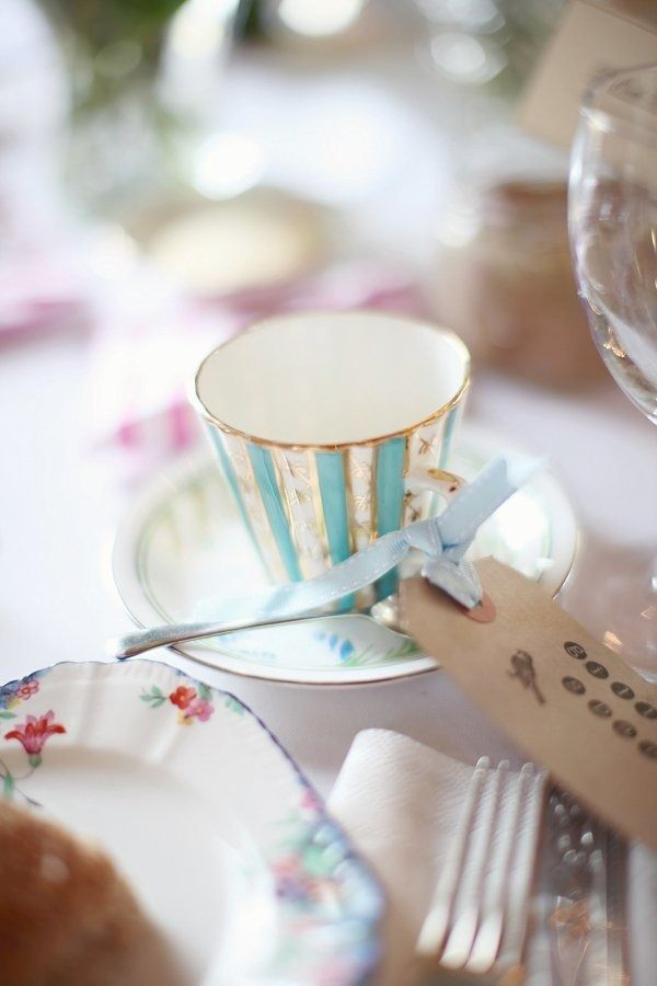 a blue striped vintage teacup with an escort card with blue ribbon is a great favor and holder idea