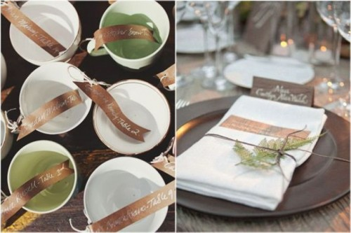 matching vintage teacups with brown escort cards for a woodland wedding