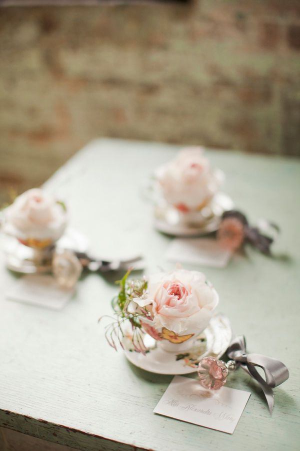 vintage teacuos with blush blooms and leaves and escort cards is a great idea for a vintage wedding