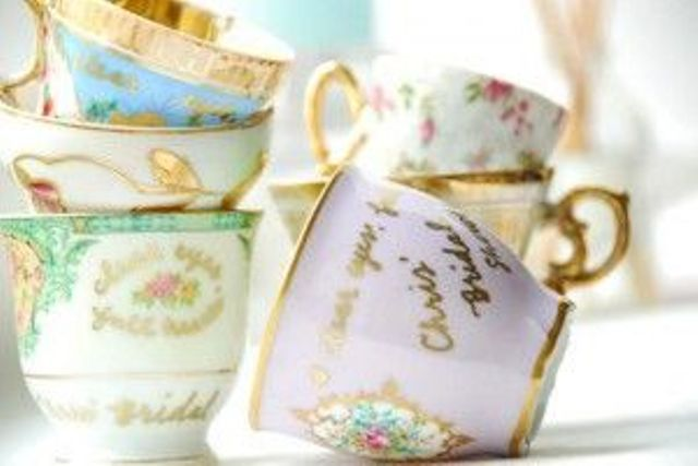 vintage teacups with gold touches are lovely wedding favors and escort card holders that won't break the bank