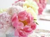 a vivacious summer wedding centerpiece of yellow, blush and coral peonies is lovely and chic