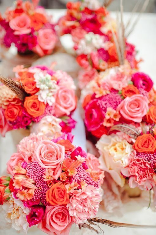 super bold summer wedding centerpeices of white jars with pink, blush, peachy blooms and berries are fun and bold