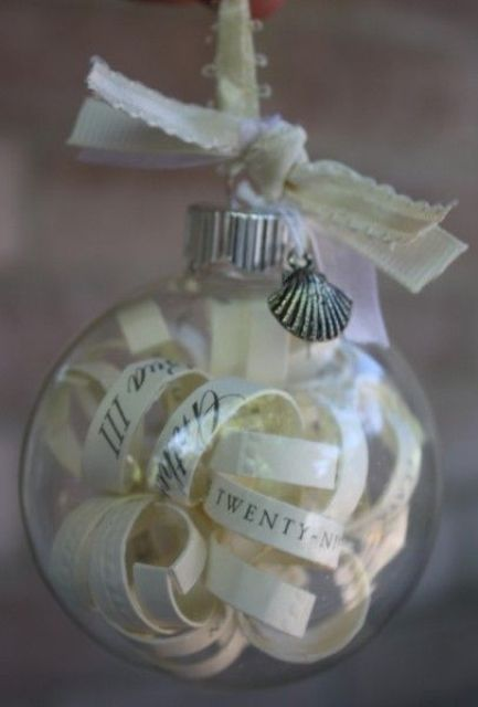 mini sheer glass ornaments filled with your favorite quotes, pages from your favorite book can be nice wedding guest favors