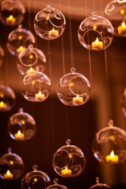 sheer bubble ornaments with mini candles inside can be hung over your cermeony space or reception to add glow to them