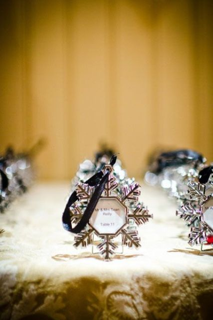 snowflake shaped ornaments with ribbons are nice winter or Christmas wedding decorations and favors