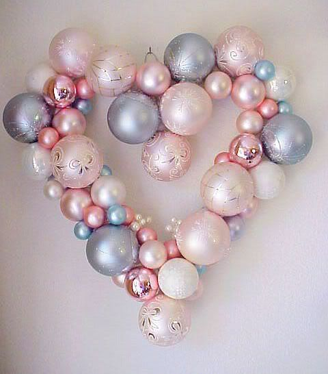 a heart shaped Christmas wreath fully made of Christmas ornaments wil be a budget friendly and cute decoration for your wedding