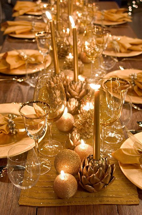 Christmas ornaments placed on the table runner and ornament-shaped candles are amazing to decorate your tables