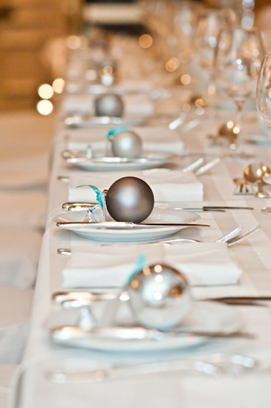 mark each place setting with little ornaments and your reception tables will get a festive feel at once
