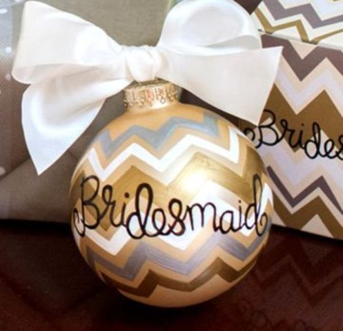 give your bridesmaids cute personalized ornaments with large bows to make them happy