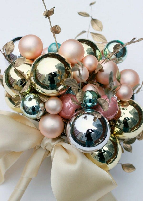 a non traditional wedding bouquet made of Christmas ornaments will help you save on budget and give you an unusual look
