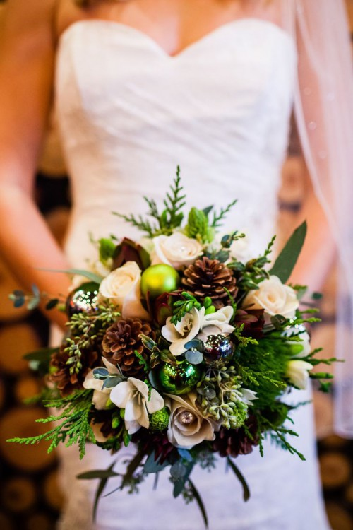 spruce up your wedding bouquet with pinecones and Christmas ornaments to make it ultimately holiday-like