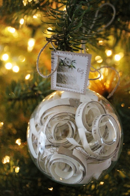 a sheer ornament filled with lines of your favorite song and with a stamp is a very cool idea for a holiday wedding