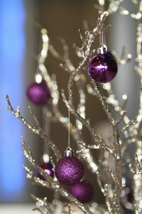 glitter and shiny purple ornaments on glitter branches are amazing for decorating your holiday wedding