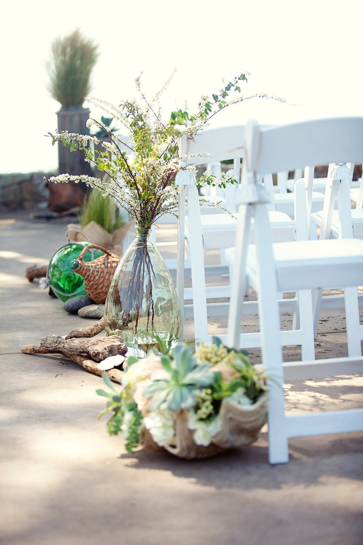 driftwood, greenery, succulents, blooms and branches for lining up the wedding aisle