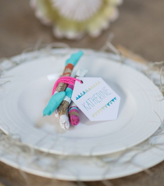 a bit of color block driftwood to mark each place setting for a beach boho wedding